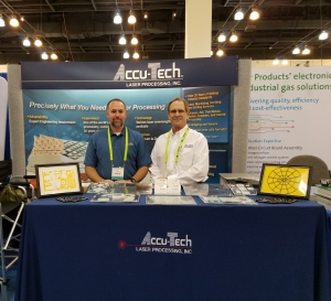 Photo of Accu-Tech Laser team members in our booth at the imaps show